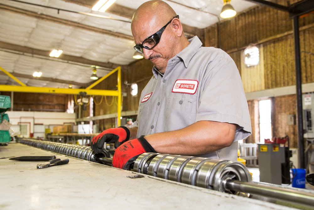 A Borets team member assembling an ESP pump in our one of our Texas service center.s